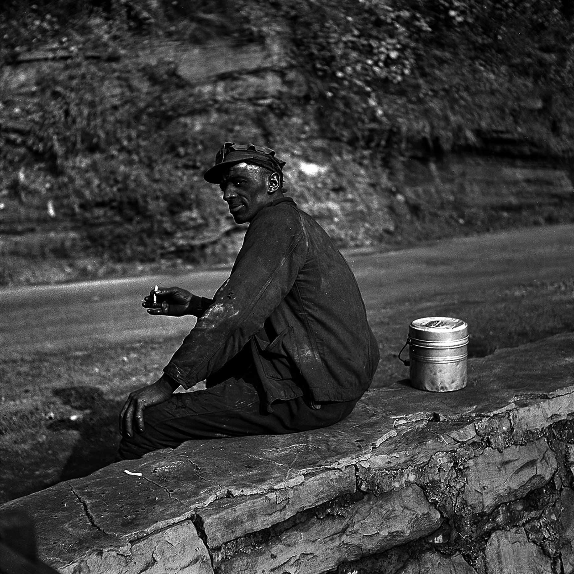 Marion Post Wolcott  -September 1938. Capels, West Virginia. Coal miner waiting for lift home - 32 X 32
