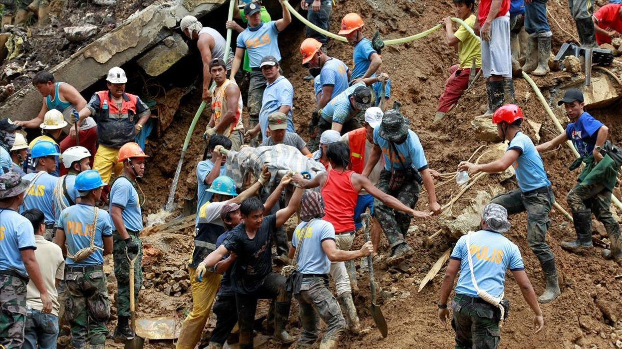 Rescuers carry a body recovered at a landslide after super typhoon Mangkhut hit the country at a mining camp in Itogon Benguet Philippines September 17 2018 REUTERS Harley Palangchao